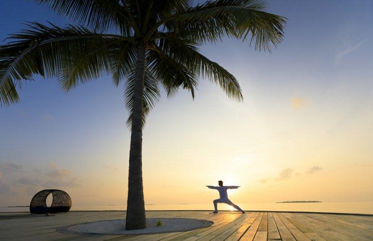 Время йоги в Dhigali Maldives